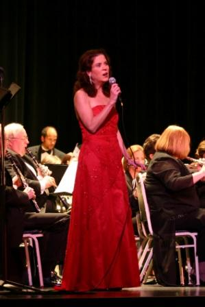Photograph of Lori Couglin performing with Patriots Band at Sandusky State Theater